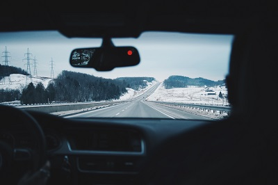 image of car driving in winter